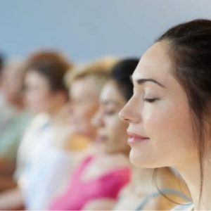 Group of people meditating | Moving Minds Hypnotherapy