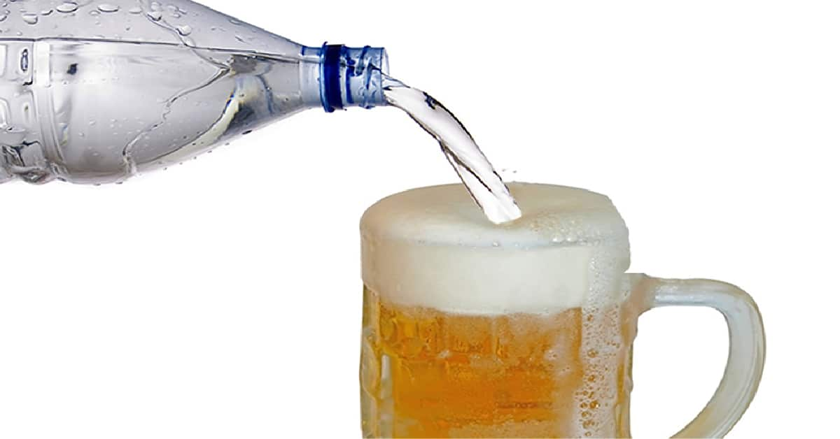 Water poured into glass with beer in it | Moving Minds Hypnotherapy