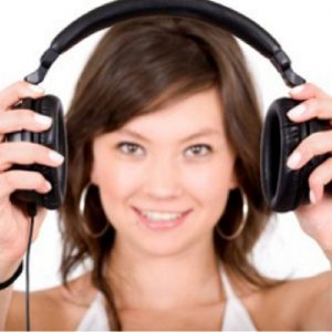Woman holding a pair of headphones | Moving Minds Hypnotherapy