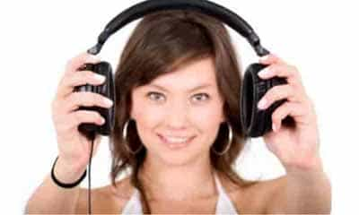 Woman holding a pair of headphones   Moving Minds Hypnotherapy